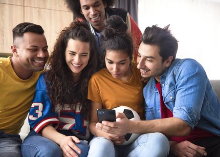 Group of friends watching something on the phone