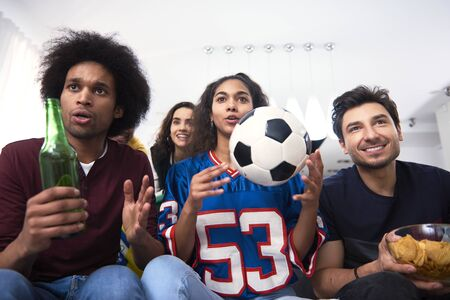 Football fans watching match and waiting for the goal
