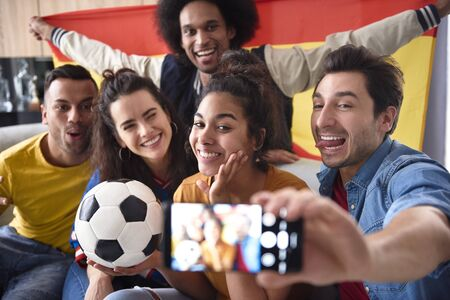 Group of football fans making selfie with funny faces