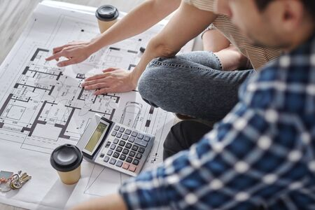 Close up of couple calculating costs of new house Stock Photo