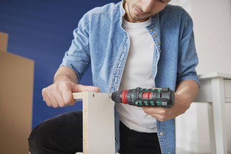 Man installing furnitures by himself