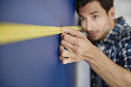Very precise man using a tape measure Stock Photo - 149655408