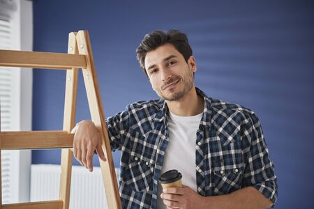 Coffee break while renovating a house