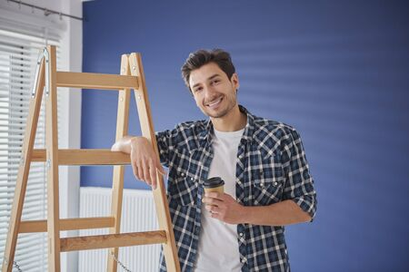 Portrait of handyman having a coffee break Stock Photo - 149975729