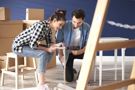 Couple in new house with furnitures ready to be installed