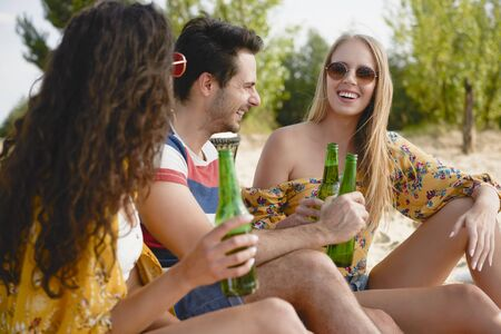 Group of friends spending nice time with beer bottles  Stock Photo