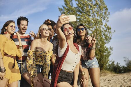 Young smiling people taking a selfie