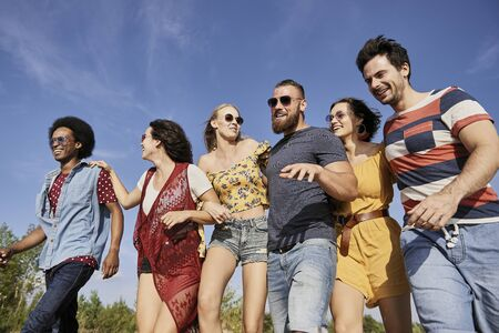 Young people in a row on the fresh air  Stock Photo