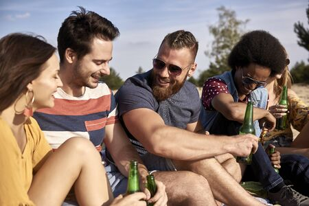 Group of friends spending time together on a sunny day Stock Photo