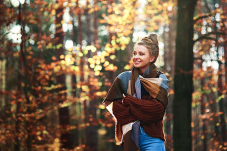 Portrait of autumnal woman with wrapped gift Stock Photo - 150627233