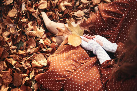 Portrait of autumnal woman with wrapped gift