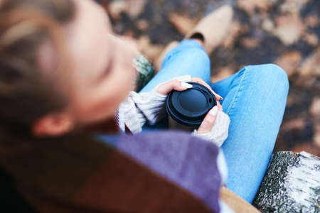 Blurred woman with a cup of coffee Stock Photo