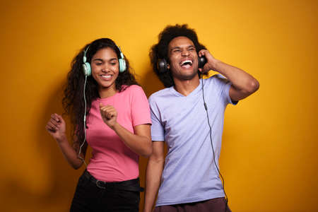 Couple having fun while listening to music