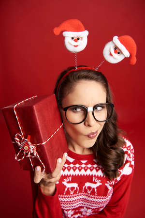 Nerd woman curious about Christmas present