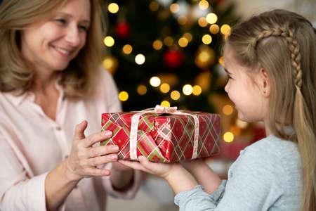 Grandma and granddaughter while giving Christmas presents