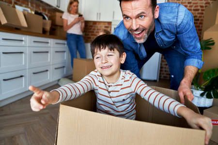 Son and father have fun during moving home