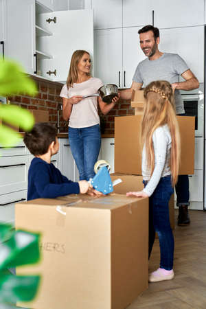 Happy family with children moving to a new home