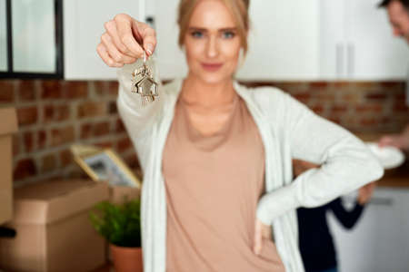 Close up of woman holding a key to her new home