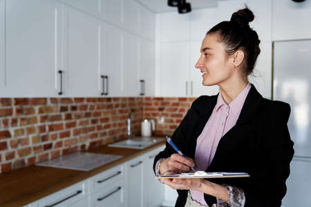 Smiling real estate agent in new apartment