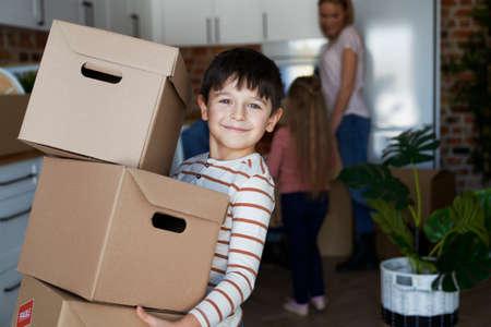 Portrait of smiling boy holding a cardboard box