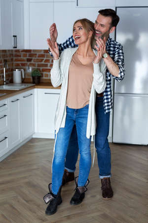 Man surprising woman in new flat
