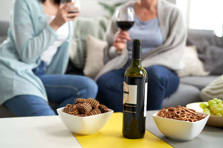 Bottle of wine and snack on the table Foto de archivo