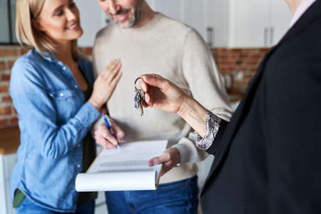 Couple signing contract of new apartment