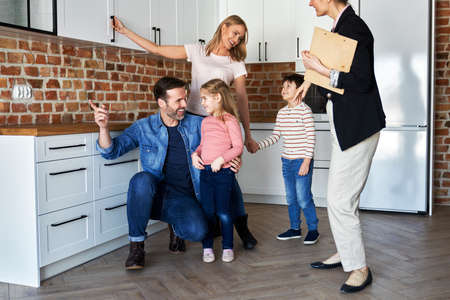 Happy family during buying a new apartment