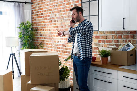 Displeased man calling for help with moving house