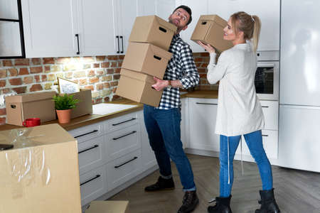 Couple take the cardboard boxes when they move out