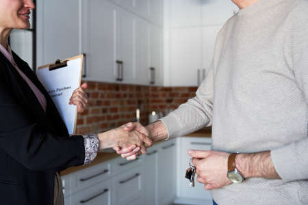 Close up of estate agent in the handshake of a customer