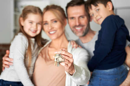 Close up of family holding key for a new apartment