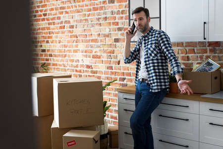 Displeased man calling during moving house