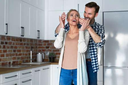 Woman surprised by a new apartment Foto de archivo