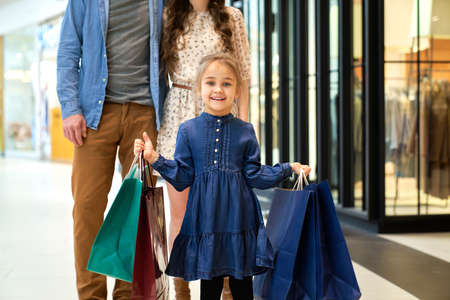 Portrait of little girl during shopping at the mall