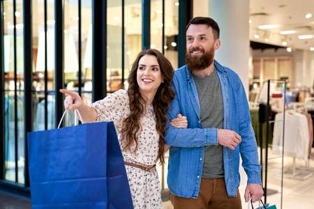 Smiling couple during shopping at the mall