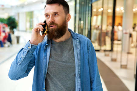 Close up of man calling while shopping at the mall