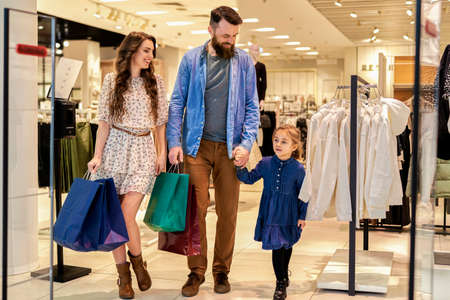 Happy family strolling in shopping mall