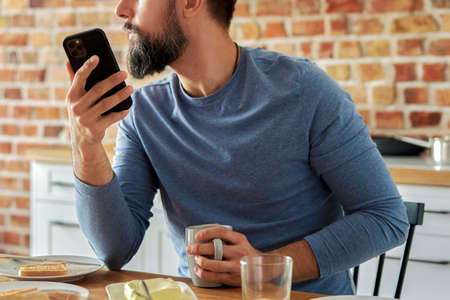 Close up of man calling during breakfast