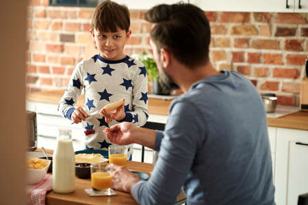 Father and son preparing breakfast together