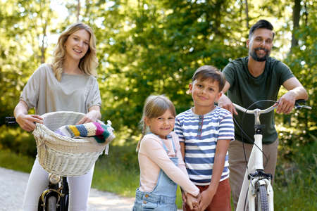 Portrait of family while bike ride in the woods