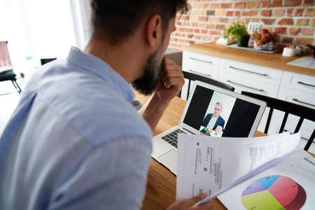 Man talking to boss on web meeting