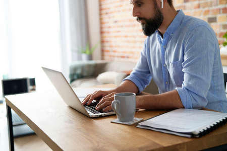 Man working on a laptop in the home office