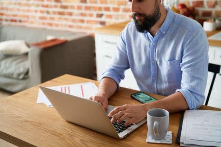 Close up of man working at home Standard-Bild