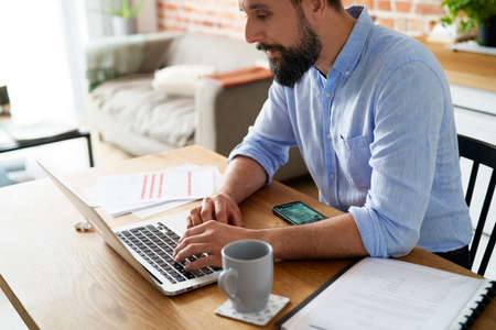 Man working using a laptop while home office