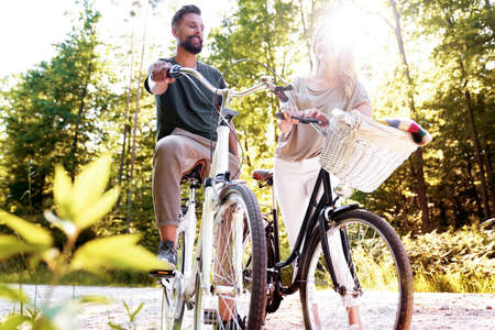Couple while bike ride on a sunny day