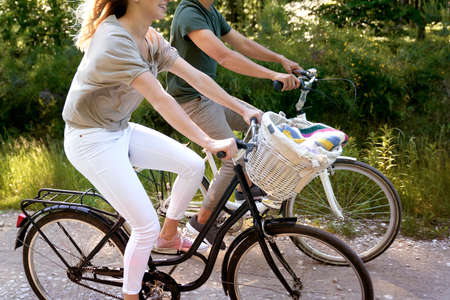 Close up of couple riding bikes in nature Standard-Bild