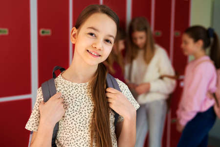 Portrait of smiling girl standing at school
