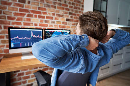 Young adult man stretching during the working about finances