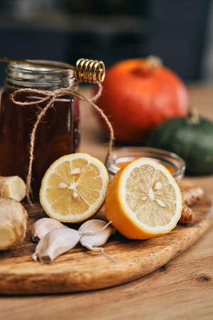 Vertical image of natural immune ingredients on wooden desk 스톡 콘텐츠